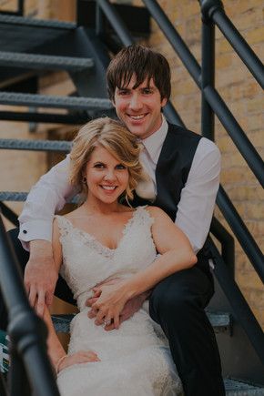 A bride and groom smile at Oshkosh wedding photographers
