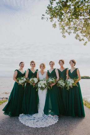 A bride and bridesmaids post for Oshkosh wedding photographers