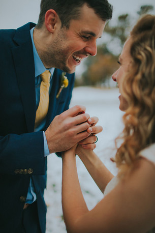 A closeup of a groom holding a bride's hands at Kadish Park Milwaukee