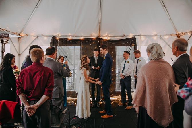 A bride and groom exchange vows during a Milwaukee wedding