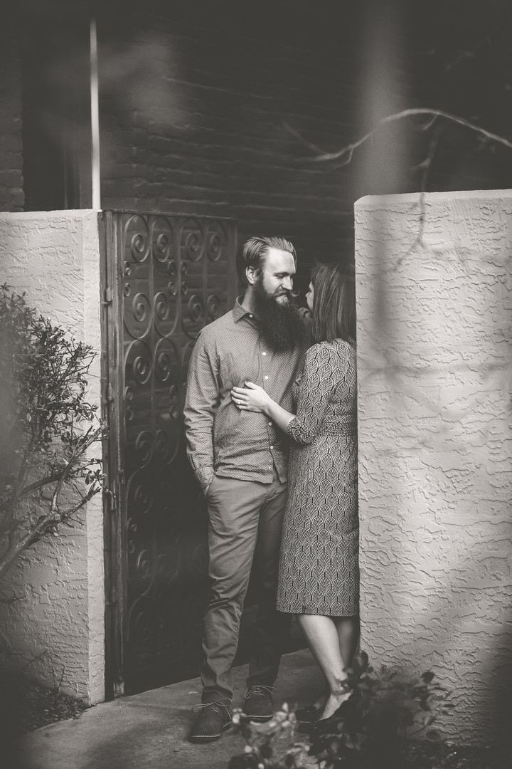 A man and woman embrace against a wall in downtown Colorado Springs, Colorado