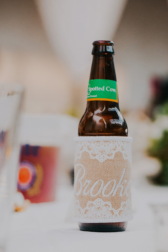 A close up of a Spotted Cow during an Oshkosh wedding