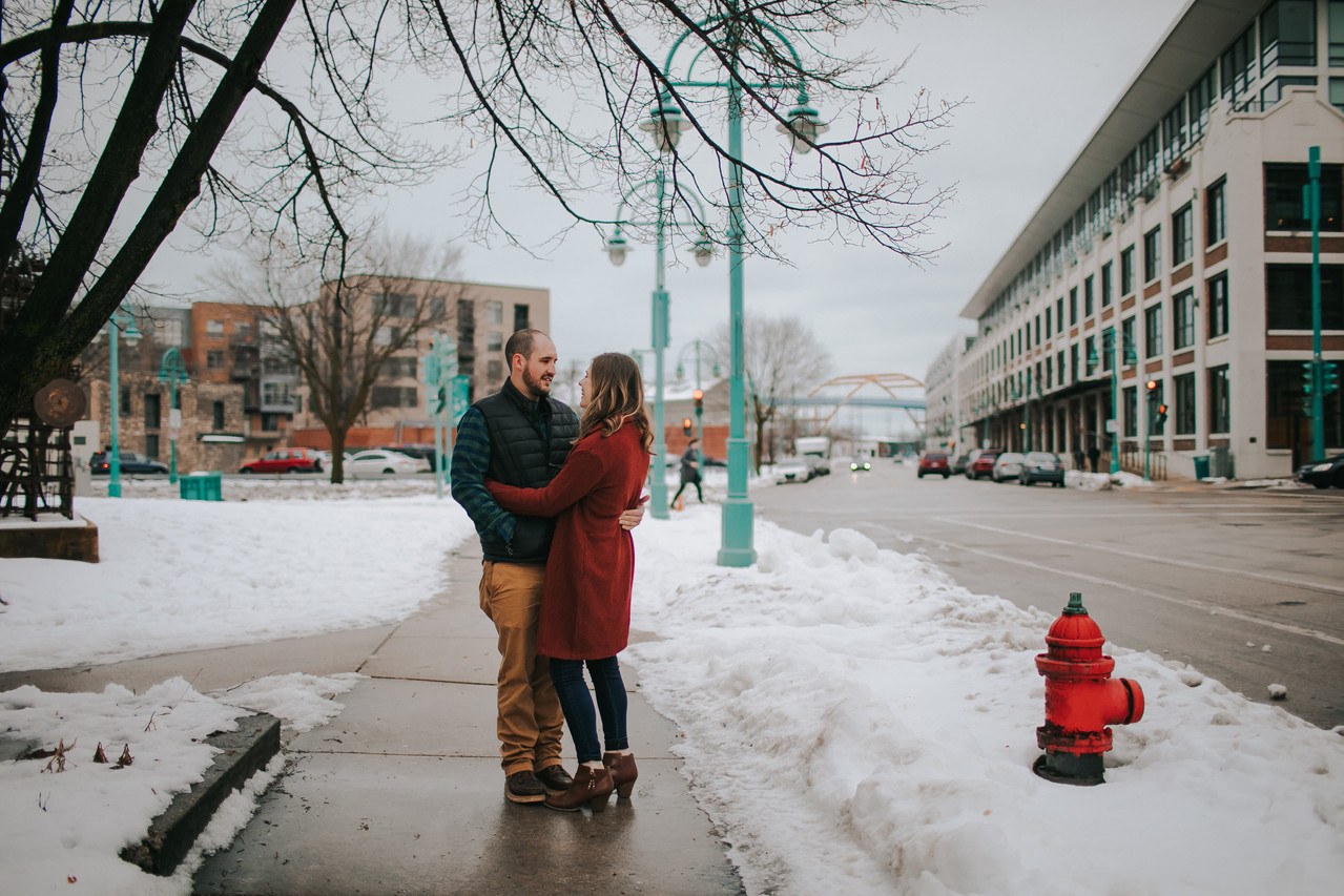A man and woman embrace in the Historic Third Ward in Milwaukee Wisconsin