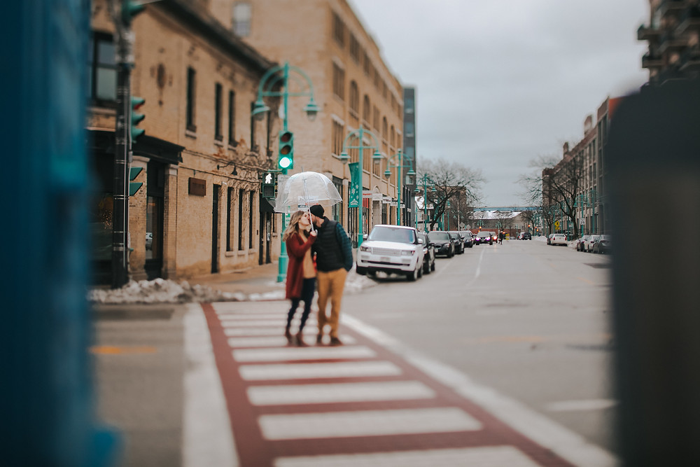 A man and woman cross the street during Historic Third Ward engagement photos