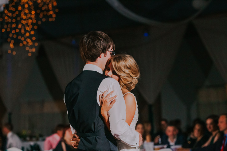 A bride and groom dance during their Beckets reception