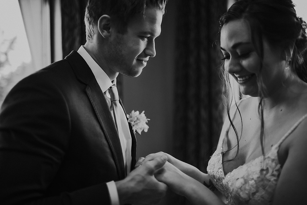 A man holds a woman's hands in his - Wisconsin wedding photographer