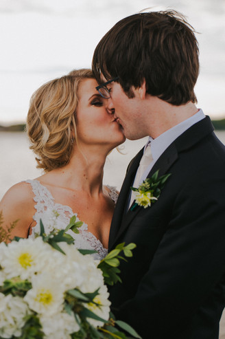 A bride and groom kiss