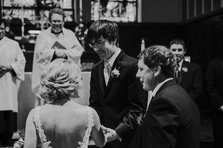 A father gives his bride away in a Wisconsin wedding