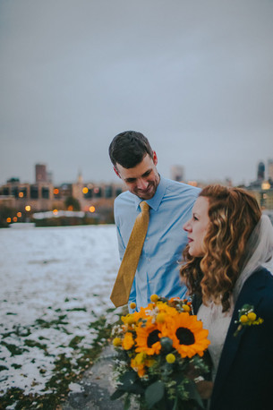 A man smiles at a woman in the city of Milwaukee