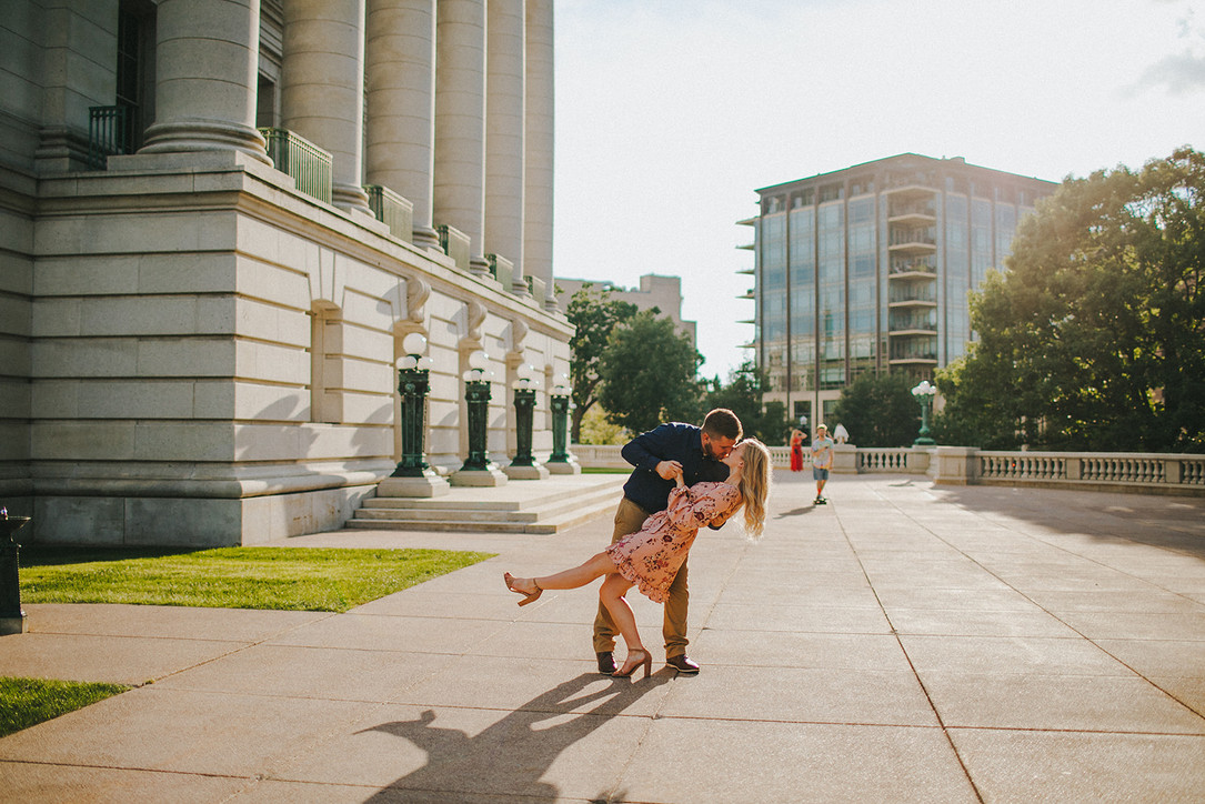A man and woman dance during their Downtown Madison engagement session