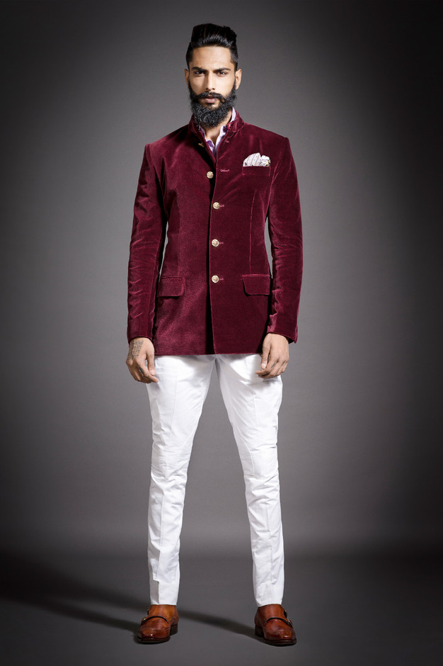 "A rich velvet ""Prince Coat"" by RR in a royal maroon colour, inspired by heirloom custom-designed buttons, paired with the Jodhpuri riding breeches"