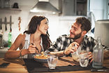 couple-eating-dinner-together-e151857326