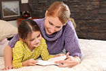 Girl_reading_with_mom_H.jpg