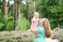 mum holding her baby up in the air during family photoshoot with surrey photographer Rachel Fairfield Photography