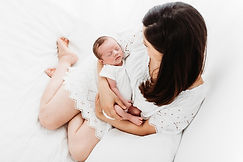 newborn baby being cuddled by his mummy in newborn photo session in Surrey studio