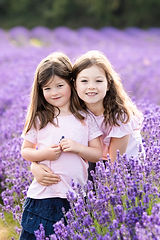 Two sisters in the lavender field at Mayfield Lavender Farm, Surrey