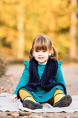 little girl looking at the camera during on location family photo session with Rachel Fairfield Photography