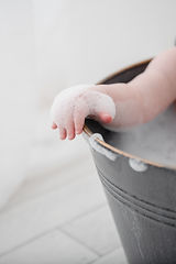 baby hand covered in bubbles in a cake smash photo session in Rachel Fairfield Photography's studio