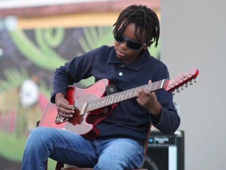 He's 11 years old. He's legally blind. He shreds like Jimi Hendrix. Meet Guitar Hero Miles Hoyt.