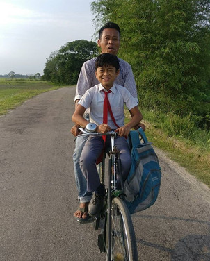 Boy returns home from school with father