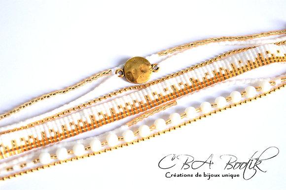 Bracelet tissé blanc et doré
