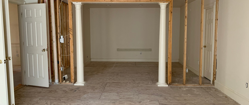 Opening up the wall which previously bisected the Master Bedroom into two separate areas