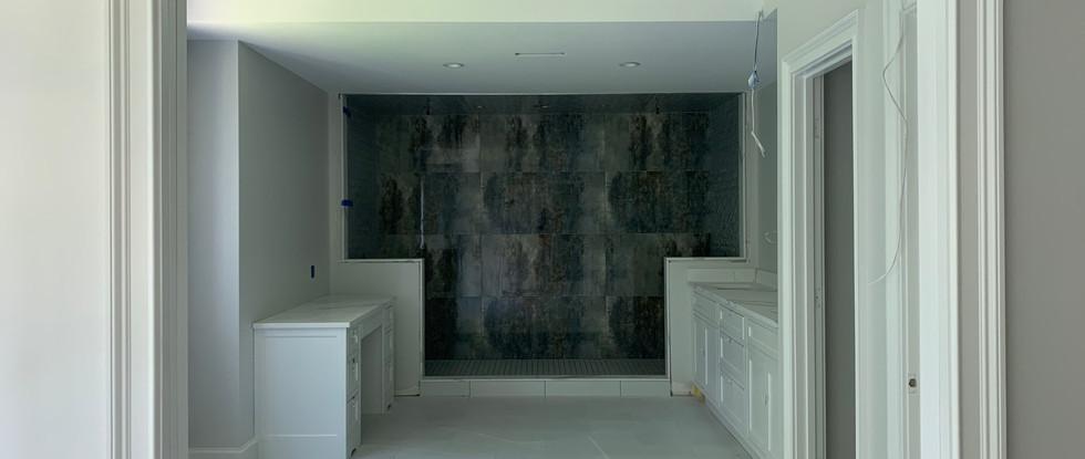 Vanities and floor installed in Master Bath