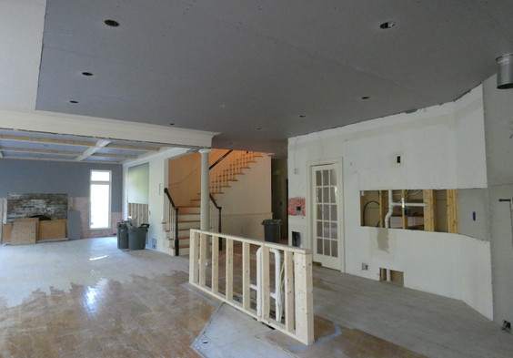 View from Kitchen to Family Room and Back Staircase.