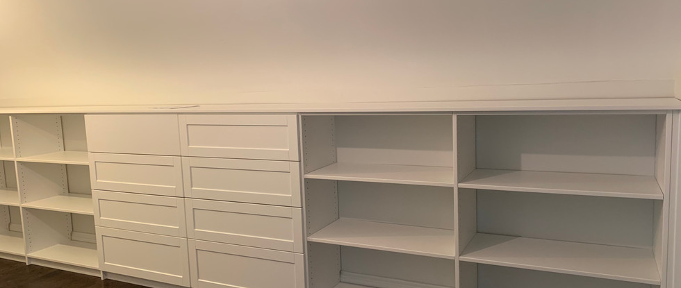 Built-in chest of drawers and shelving