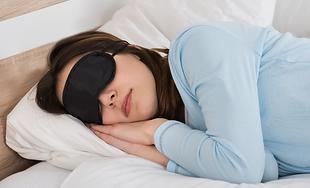 woman-sleeping-with-sleep-mask.png