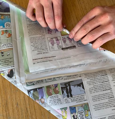 Start rolling newspaper.jpeg