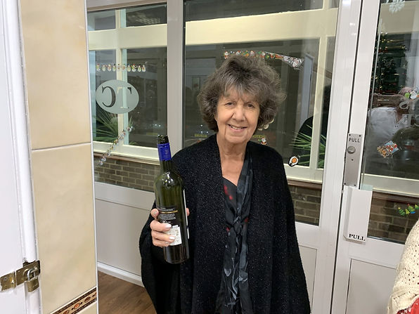 Committee Member Annette with Wine.JPG