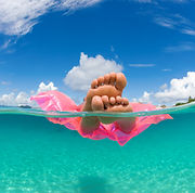 woman floating on inflatable raft relaxi