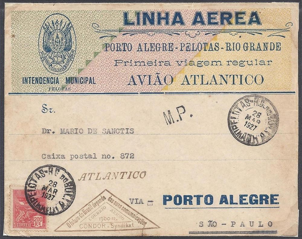 28 MAR 1927 – Pelotas/São Paulo – 1º porte interno ($200 Rs) mais 1º porte aéreo (1$300 Rs – carimbo triangular) Envelope comemorativo distribuído pela Prefeitura Municipal de Pelotas. Imagem reduzida a 80%.