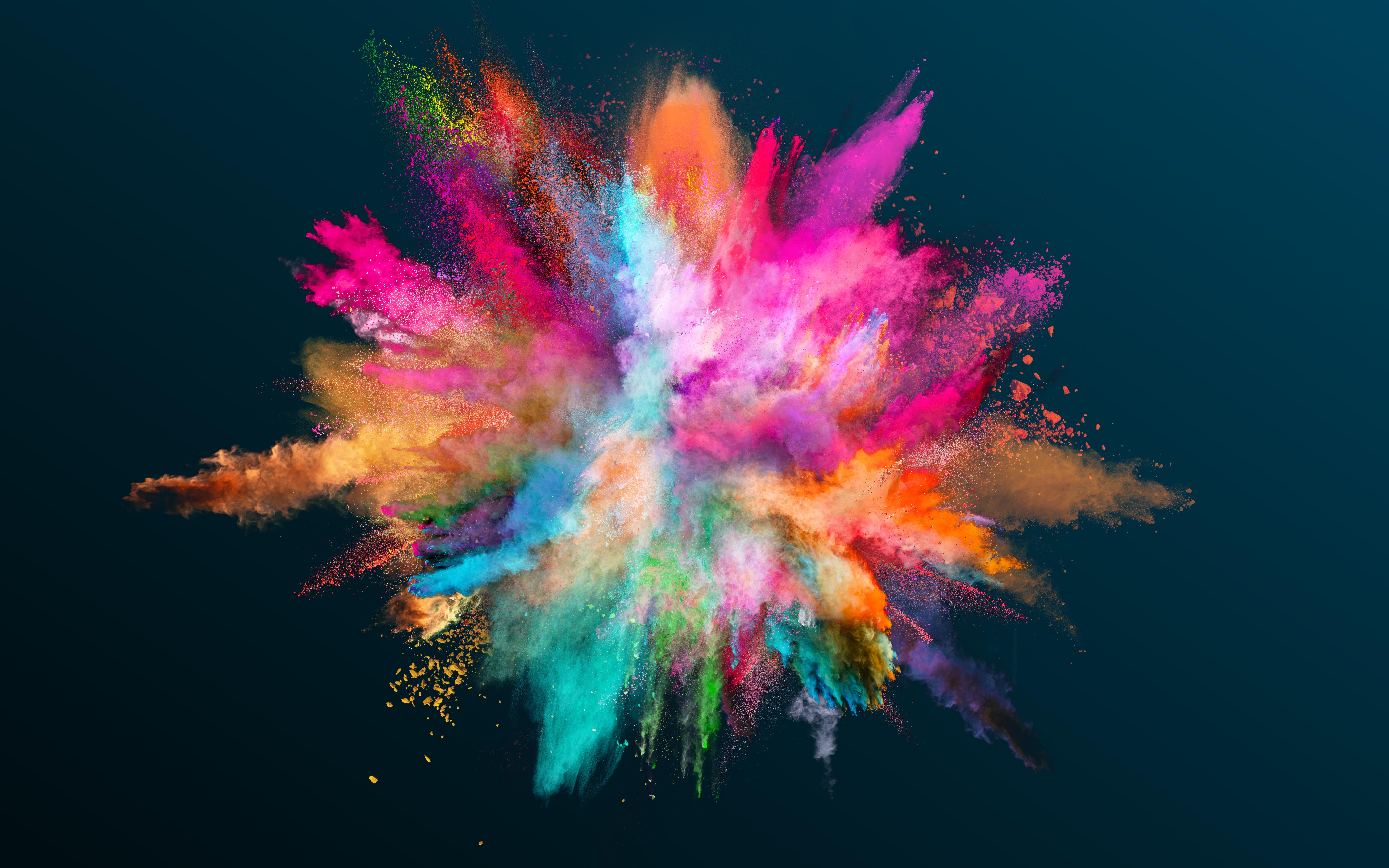 Colored powder explosion on black backgr