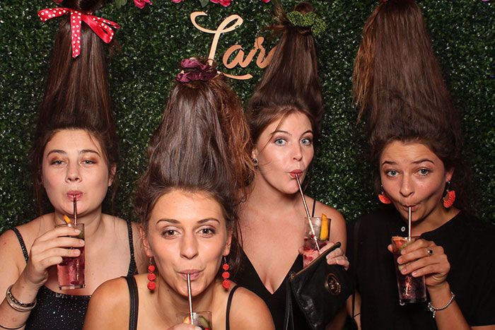 girls with hair up in the photo booth