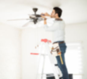 Profile view of a male electrician stepp