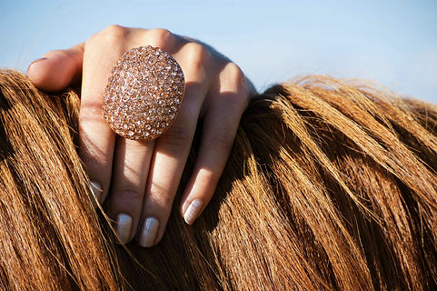 This ring is a real show-stopper. This massive ring from Le Chateau packs more than a little bling with its beautiful rose-gold finish encrusted with matching rhinestones.