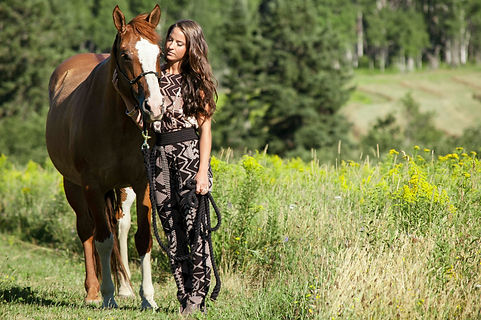 The relationship between a girl and her horse. This outfit features rose-gold accessories and tribal print matching separates from Le Chateau.