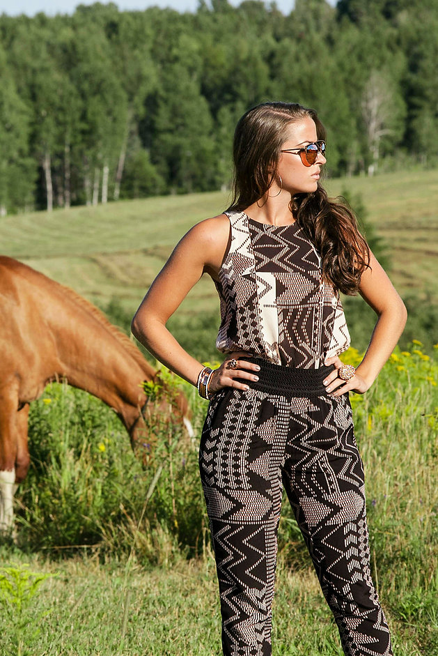 Set against a backdrop of rolling hay fields, this outfit features gorgeous rose-gold accessories and tribal print matching separates from Le Chateau of Montreal.