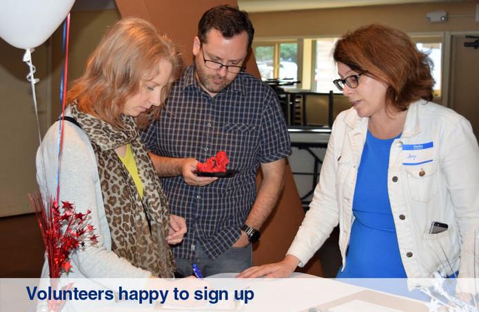 Volunteers happy to sign up.jpg