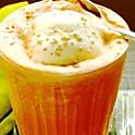 Fresh carrot juice with saffron ice cream
