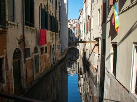Canal Reflection with Rainbow Flag.jpg