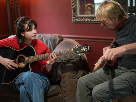 Amelie and Keech guitars intent.jpg