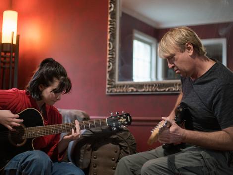 Amelie and Keech guitars both intent.jpg