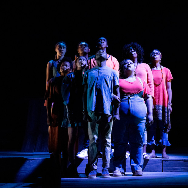 Photo Derived from Ball State's production of Marcus; Or The Secret Of Sweet. Directed be Matt Reeder and Andre Garner, Set design by Kerry Chipman, Costume by Emily Bouche, Lights and projection by Connor Blackwood, Photography by Kip Shawger. From left to right Michaela League, Shelby Brown, Hanna Whitley, Jake Letts, Ogunde Snelling Jr, Devion Ross, Janae Robinson, Erica Dilworth, and Zariyah Butler