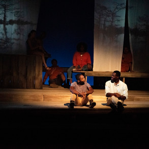 Photo Derived from Ball State's production of Marcus; Or The Secret Of Sweet. Directed be Matt Reeder and Andre Garner, Set design by Kerry Chipman, Costume by Emily Bouche, Lights and projection by Connor Blackwood, Photography by Kip Shawger. Ogunde Snelling Jr and Dash Perry
