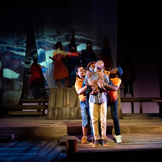 Photo Derived from Ball State's production of Marcus; Or The Secret Of Sweet. Directed be Matt Reeder and Andre Garner, Set design by Kerry Chipman, Costume by Emily Bouche, Lights and projection by Connor Blackwood, Photography by Kip Shawger. From left to right, Jake Letts, Emmanuel Simon, Ogunde Snelling Jr, and Devion Ross