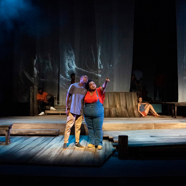 Photo Derived from Ball State's production of Marcus; Or The Secret Of Sweet. Directed be Matt Reeder and Andre Garner, Set design by Kerry Chipman, Costume by Emily Bouche, Lights and projection by Connor Blackwood, Photography by Kip Shawger. Ogunde Snelling Jr and Janae Robinson