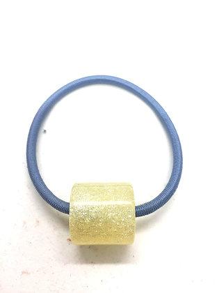 Élastique avec ornement cylindrique